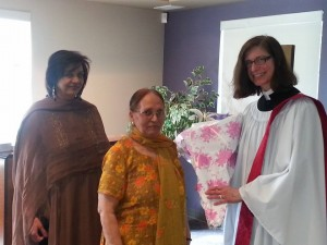 Marion Karasiuk presented with flowers after preaching